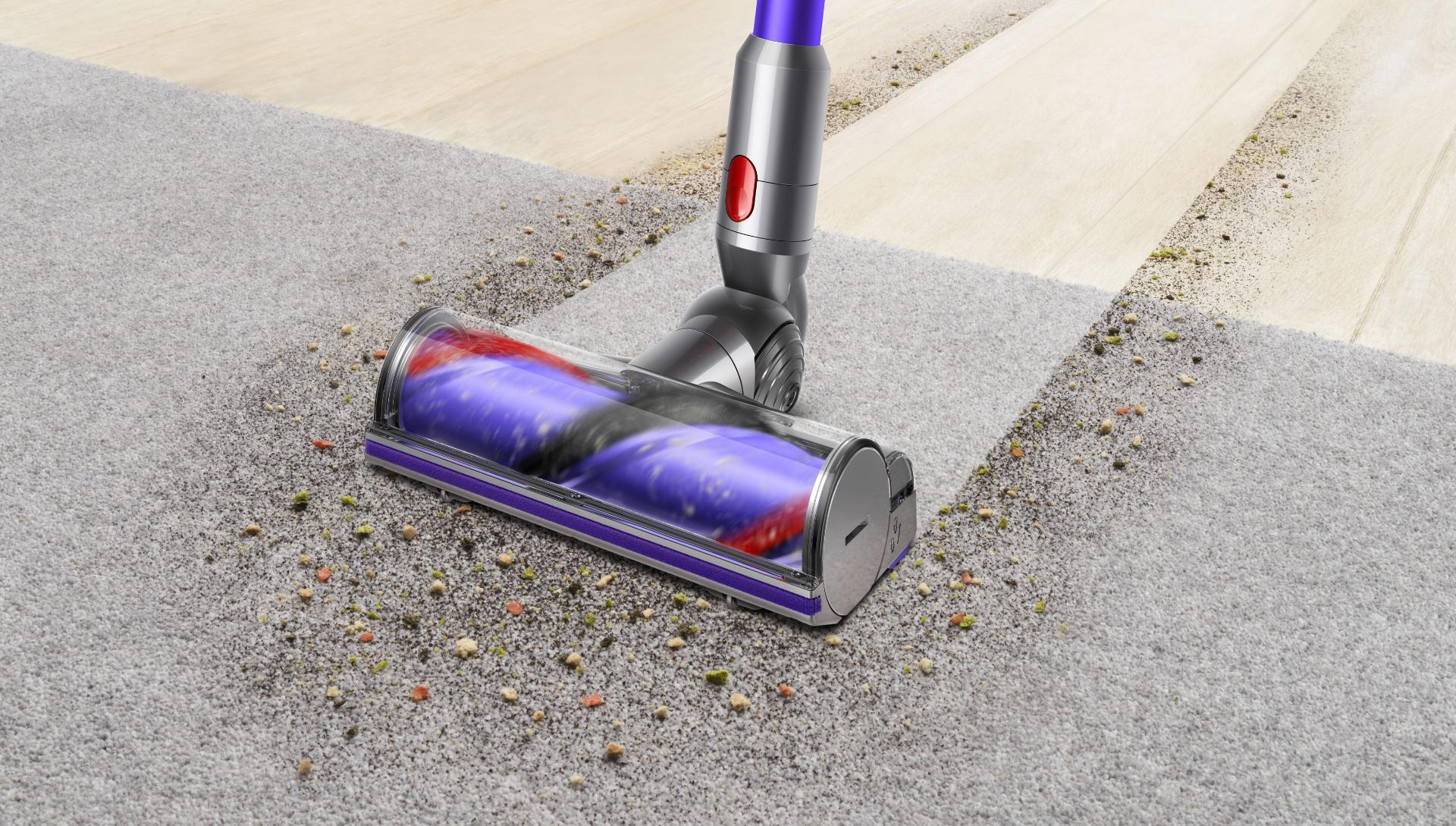 Woman cleaning floor using Dyson cyclone V10 vacuum cleaner