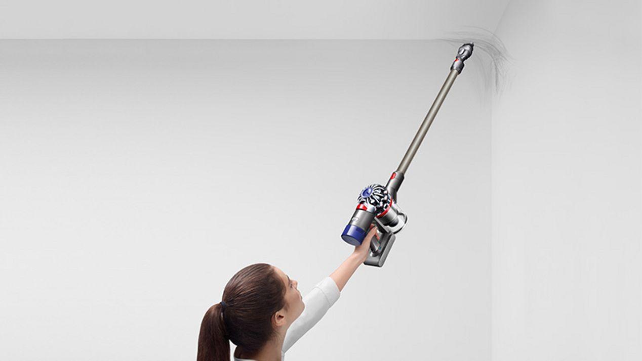 Model with Dyson V8 Animal vacuum