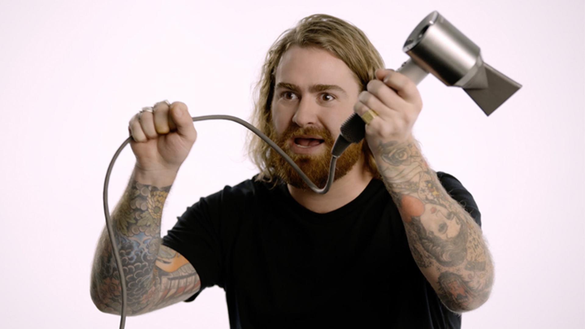 Hair stylist holding the long cable of the Dyson Supersonic™ hair dryer Professional edition