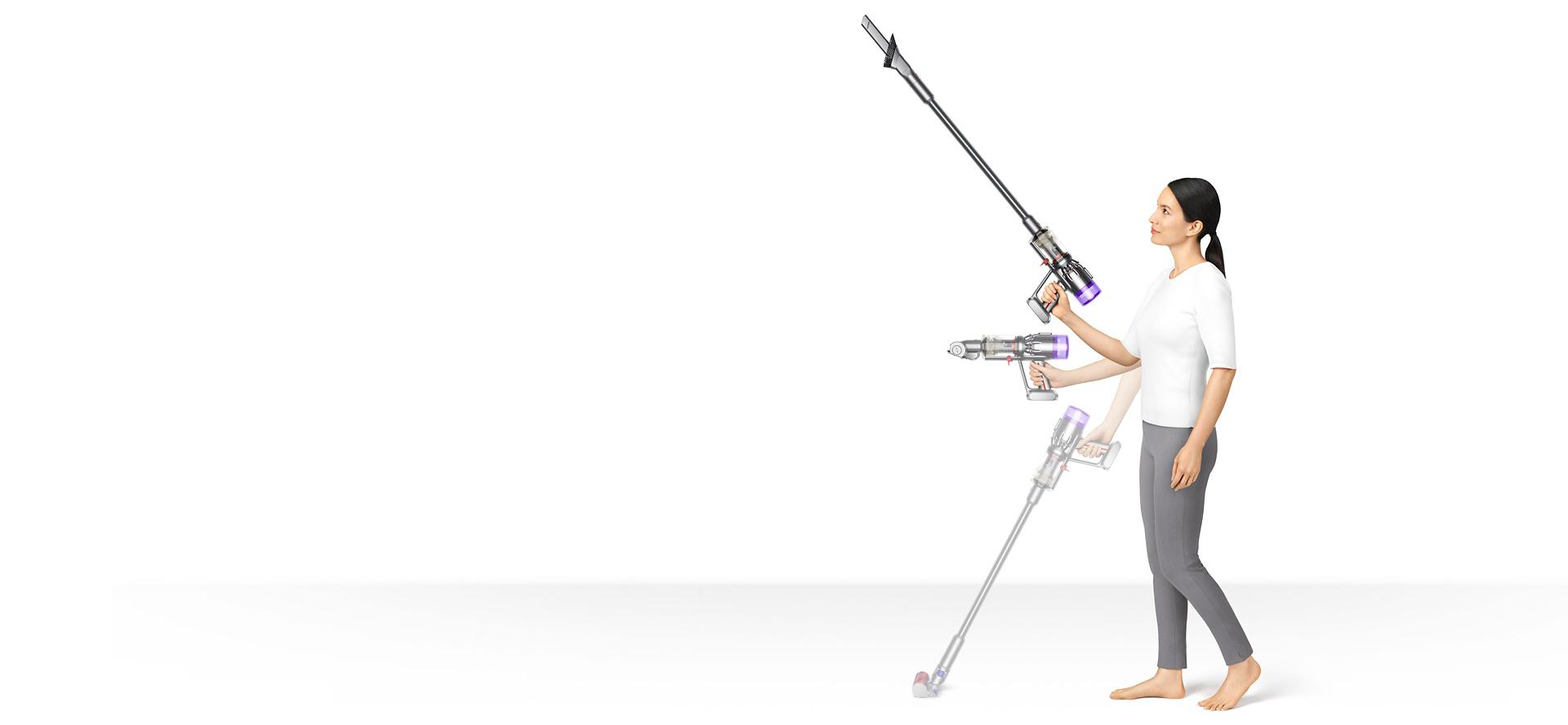 Woman holding Dyson Micro 1.5kg in three different positions